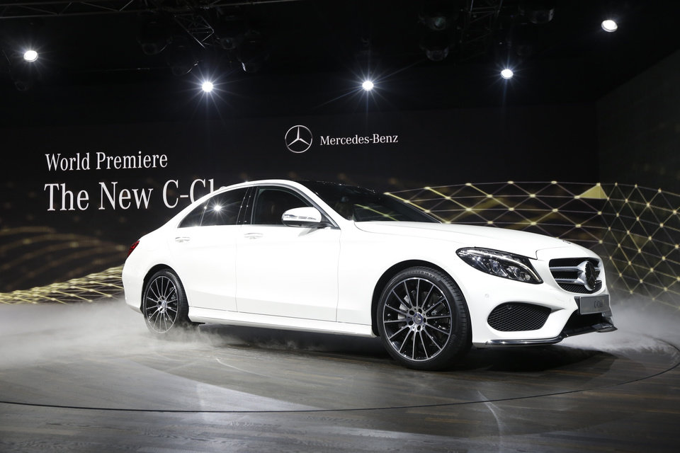 Photo - Mercedes Benz unveils the new C-Class car during a preview night for the North American International Auto Show in Detroit, Sunday, Jan. 12, 2014. (AP Photo/Carlos Osorio)
