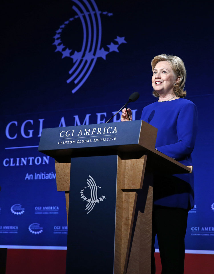 Photo - Former Secretary of State Hillary Rodham Clinton speaks to gathered participants at the annual gathering of the Clinton Global Initiative America, at the Sheraton Downtown, in Denver, Tuesday, June 24, 2014. (AP Photo/Brennan Linsley)