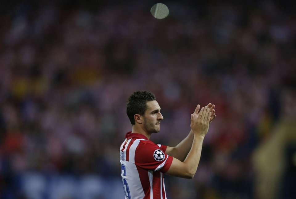 Photo - Atletico's Koke applauds to Atletico supporters at the end of the Champions League quarterfinal second leg soccer match between Atletico Madrid and FC Barcelona at the Vicente Calderon stadium in Madrid, Spain, Wednesday, April 9, 2014. (AP Photo/Andres Kudacki)