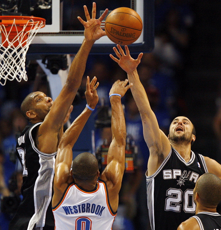 Photo - San Antonio's Tim Duncan (21) and Manu Ginobili (20) defend Oklahoma City's Russell Westbrook (0) during Game 3 of the Western Conference Finals between the Oklahoma City Thunder and the San Antonio Spurs in the NBA playoffs at the Chesapeake Energy Arena in Oklahoma City, Thursday, May 31, 2012.  Photo by Nate Billings, The Oklahoman