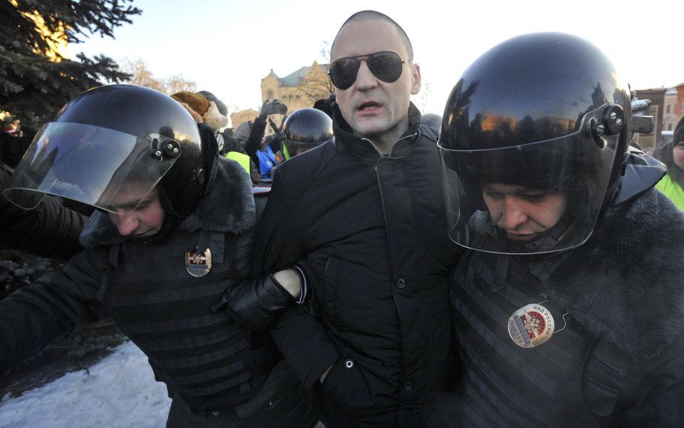 Photo - Opposition leader Sergei Udaltsov is detained by police during an unauthorized rally in Lubyanka Square in Moscow, Saturday, Dec. 15, 2012. Thousands of opposition supporters gathered Saturday in central Moscow for an unauthorized rally to mark a year of a wave of massive protests against Vladimir Putin and the government. Several prominent opposition figures were detained in the course of the gathering, which was not sanctioned by authorities. (AP Photo)