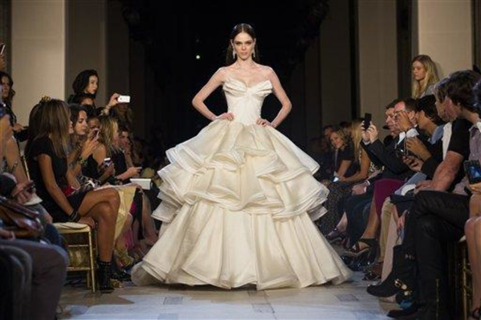 Model Coco Rocha walks the runway as the Zac Posen Spring 2013 collection is modeled during Fashion Week in New York, Sunday, Sept. 9, 2012. (AP Photo/John Minchillo)