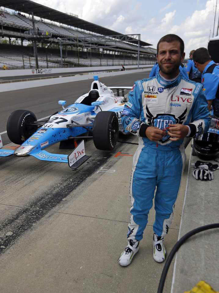 Photo - E. J. Viso, of Venezuela, looks down the pit lane after running laps during practice for Indianapolis 500 IndyCar auto race at the Indianapolis Motor Speedway in Indianapolis, Sunday, May 11, 2014. (AP Photo/Michael Conroy)