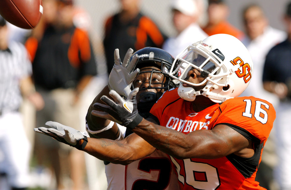 OSU's Perrish Cox (16) defends on Texas Tech's Edward Britton during the first half of the college football game between the Oklahoma State University Cowboys (OSU) and the Texas Tech University Red Raiders (TTU) at Boone Pickens Stadium  on Saturday, Sept. 22, 2007, in Stillwater, Okla. 