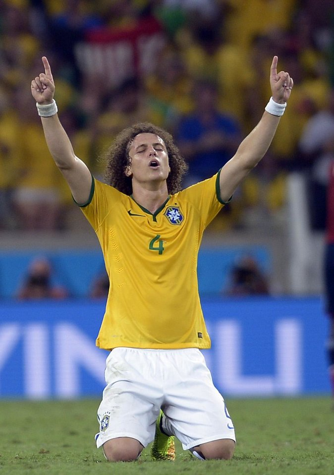 Photo - Brazil's David Luiz celebrates at the end of the World Cup quarterfinal soccer match between Brazil and Colombia at the Arena Castelao in Fortaleza, Brazil, Friday, July 4, 2014. Brazil won the match 2-1. (AP Photo/Manu Fernandez)