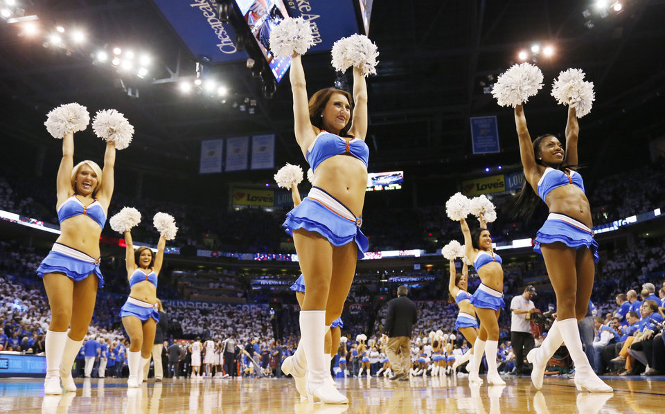 Photo - The Thunder Girls dance team performs during Game 2 in the first round of the NBA playoffs between the Oklahoma City Thunder and the Houston Rockets at Chesapeake Energy Arena in Oklahoma City, Wednesday, April 24, 2013. Oklahoma City won, 105-102. Photo by Nate Billings, The Oklahoman
