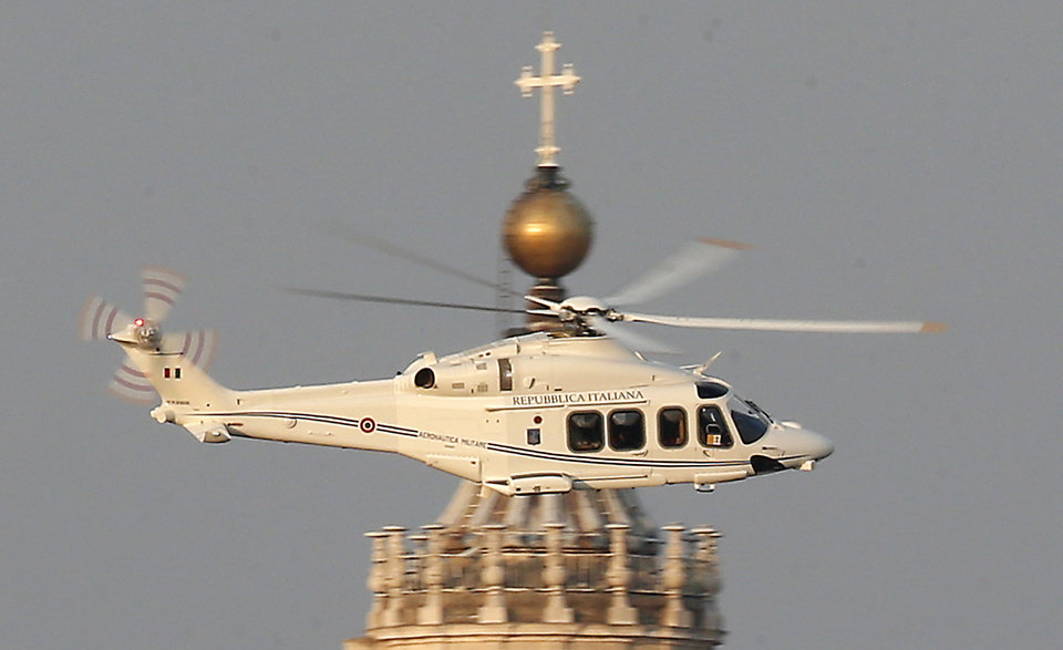 Photo - RETRANSMISSION OF SOB103 TO PROVIDE DIFFERENT CROP -- A helicopter with Pope Benedict XVI onboard leaves the Vatican in Rome, Thursday, Feb. 28, 2013. The 85-year-old German Pope Benedict is stepping down on Thursday evening, the first pope to do so in 600 years, after saying he no longer has the mental or physical strength to vigorously lead the world's 1.2 billion Catholics. (AP Photo/Michael Sohn)