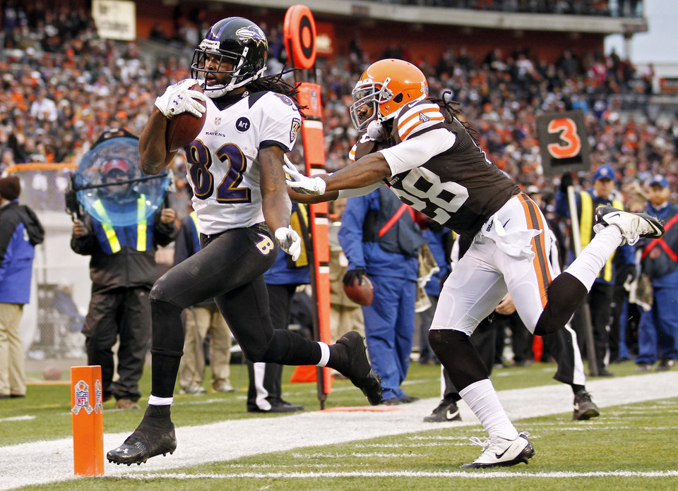 Photo -   Baltimore Ravens wide receiver Torrey Smith (82) beats Cleveland Browns safety Usama Young to the goal line on a 19-yard touchdown catch in the fourth quarter of an NFL football game in Cleveland, Sunday, Nov. 4, 2012. (AP Photo/Rick Osentoski)