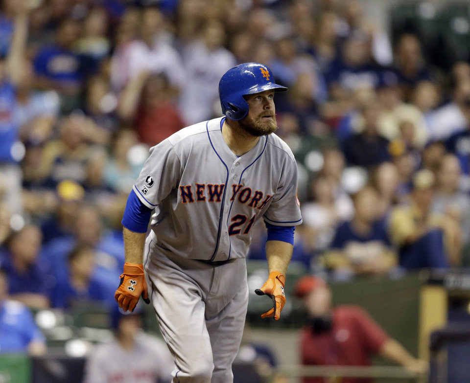 Photo - New York Mets' Lucas Duda watches his two-run home run against the Milwaukee Brewers during the ninth inning of a baseball game Friday, July 25, 2014, in Milwaukee. (AP Photo/Jeffrey Phelps)