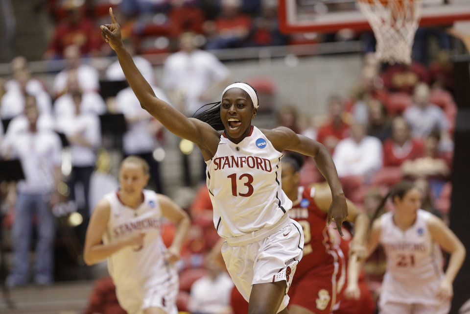 Photo - FILE - In this March 22, 2014 file photo, Stanford's Chiney Ogwumike (13) celebrates after scoring in the first half of a first-round game in the NCAA women's college basketball tournament against South Dakota in Ames, Iowa. Ogwumike was selected to The Associated Press women's basketball All-America team, released Tuesday, April 1, 2014. (AP Photo/Nati Harnik, File)