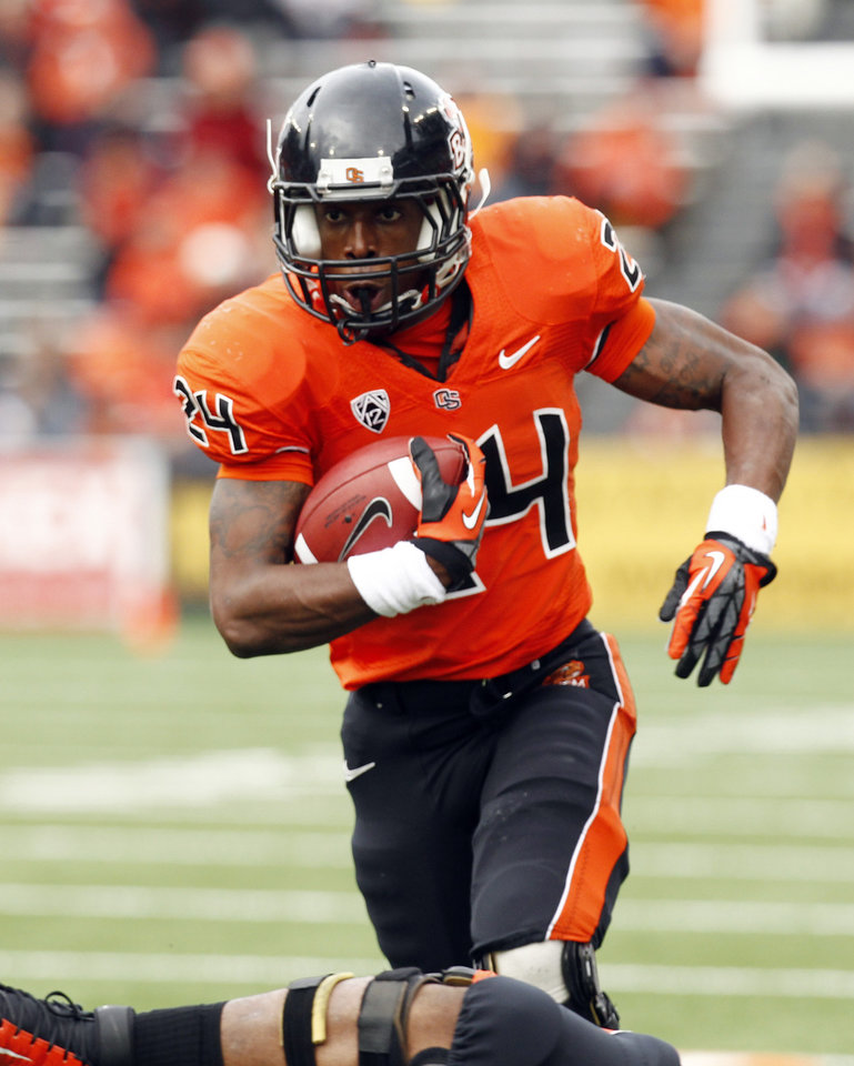 Photo - Oregon State running back Storm Woods gains yardage during the first half of an NCAA college football game against Nicholls State in Corvallis, Ore., Saturday, Dec. 1, 2012. (AP Photo/Don Ryan)
