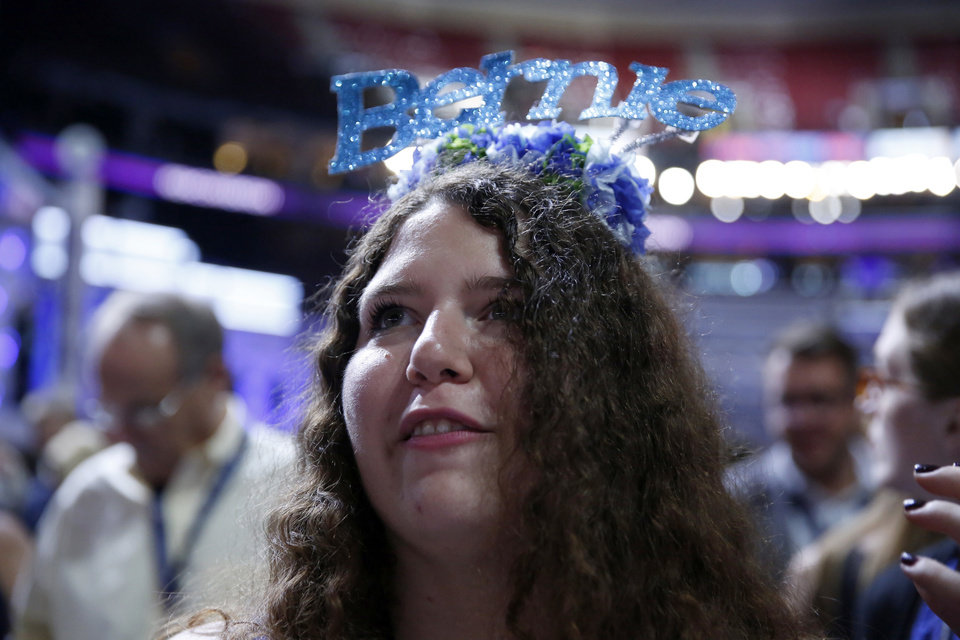 Photo - Pennsylvania delegate Amanda McIllmurray watches during the first day of the Democratic National Convention in Philadelphia, Monday, July 25, 2016. (AP Photo/Matt Rourke)
