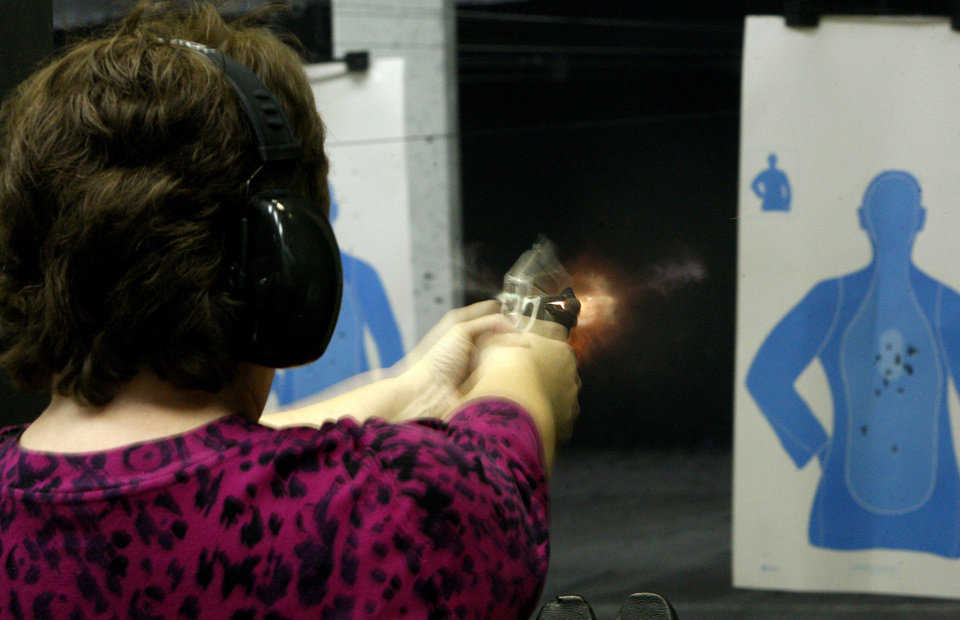 Peggy Osterholt of Okarche, Okla, fires her handgun inside H&H Shooting Sports Complex in Oklahoma City, Tuesday, March 20, 2012. Photo by Bryan Terry, The Oklahoman