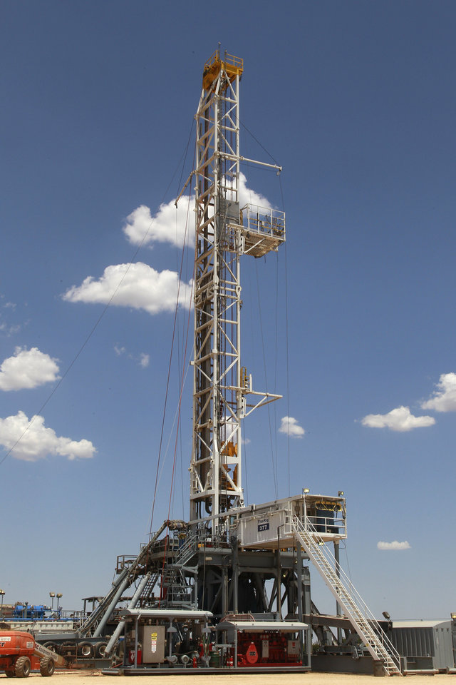 Photo -   FILE - In this Friday, July 20, 2012 file photo, a drilling rig is pictured near Calumet, Okla. America's decision to re-elect President Barack Obama over Republican presidential candidate, former Massachusetts Gov. Mitt Romney will impact key sectors of the American economy. The boom in U.S. oil and gas production during the president's first term will likely continue, thanks largely to new drilling techniques. But drilling could slow if the Environmental Protection Agency toughens rules governing a controversial technique called hydraulic fracturing. (AP Photo/Sue Ogrocki)