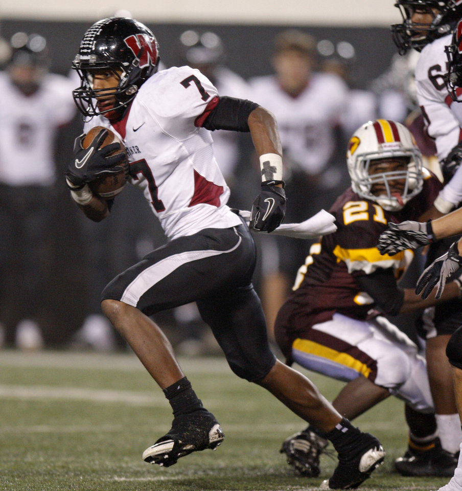 Wagoner\'s Kevin Peterson runs during the class 4A state championship high school football game against Clinton at Boone Pickens Stadium in Stillwater, Okla., Friday, Dec. 2, 2011. Photo by Bryan Terry, The Oklahoman