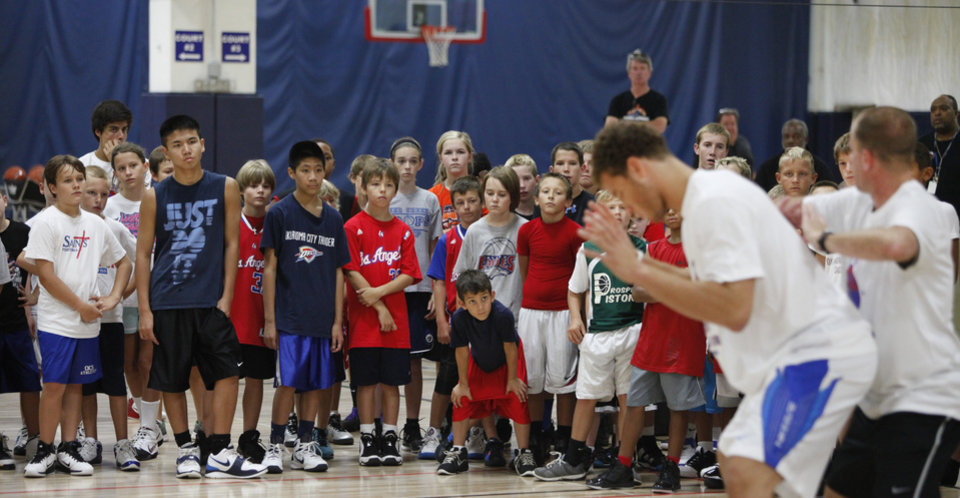 Campers watch Blake Griffin, left and Coach Mike Moreau during Griffin\'s basketball camp in Oklahoma City, August 02, 2011. Photo by Steve Gooch