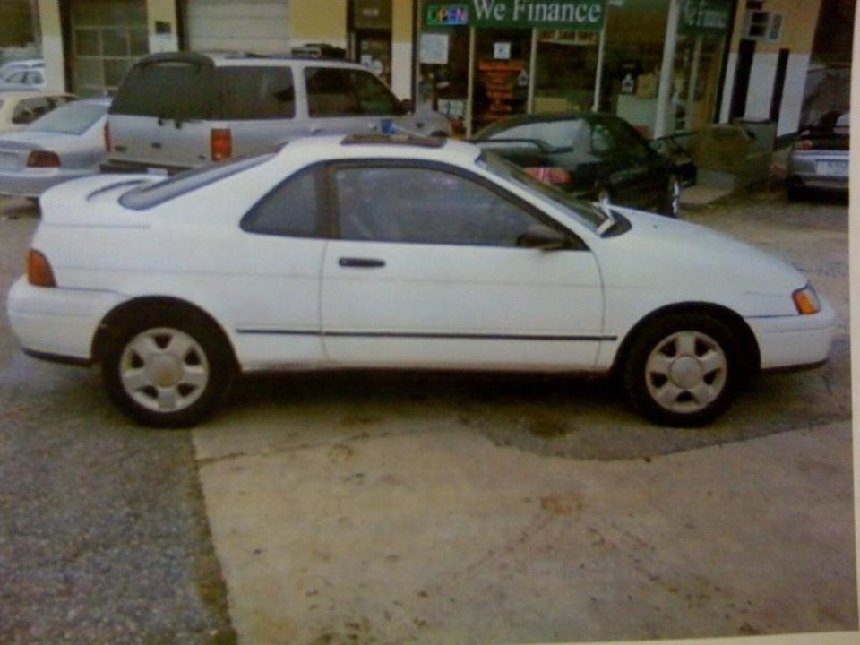 Photo - **CORRECTS SPELLING OF AJA IN SECOND SENTENCE** An undated photo provided by the Oklahoma State Bureau of Investigation shows a 1992 Toyota Paseo with the Oklahoma license plate number 577-BPW. Authorities believe it is the car being driven by Lester Hobbs, 47, who authorities say is a person of interest in the disappearance of Aja Danielle Johnson, 7.  An Amber alert has been issued Monday, Jan. 25, 2010, for Johnson, whose mother was found dead inside a home in Geronimo, Ok.,  on Sunday.  (AP Photo/Oklahoma State Bureau of Investigation) ORG XMIT: OKHO103