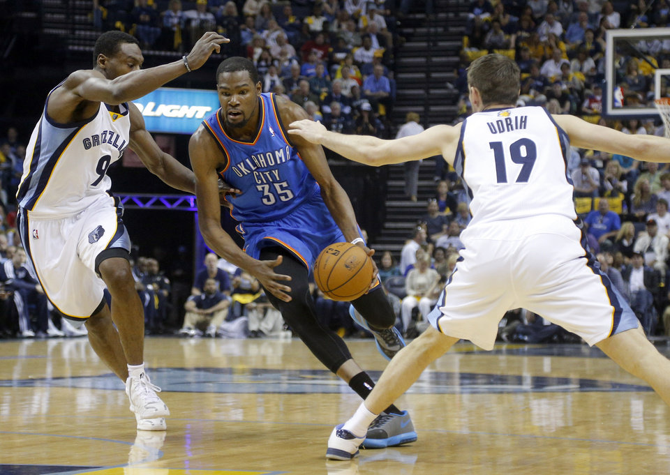 Oklahoma City's Kevin Durant (35) drives in between Memphis' Tony Allen (9) and Beno Udrih (19) during Game 6  in the first round of the NBA playoffs between the Oklahoma City Thunder and the Memphis Grizzlies at FedExForum in Memphis, Tenn., Thursday, May 1, 2014. Photo by Bryan Terry, The Oklahoman