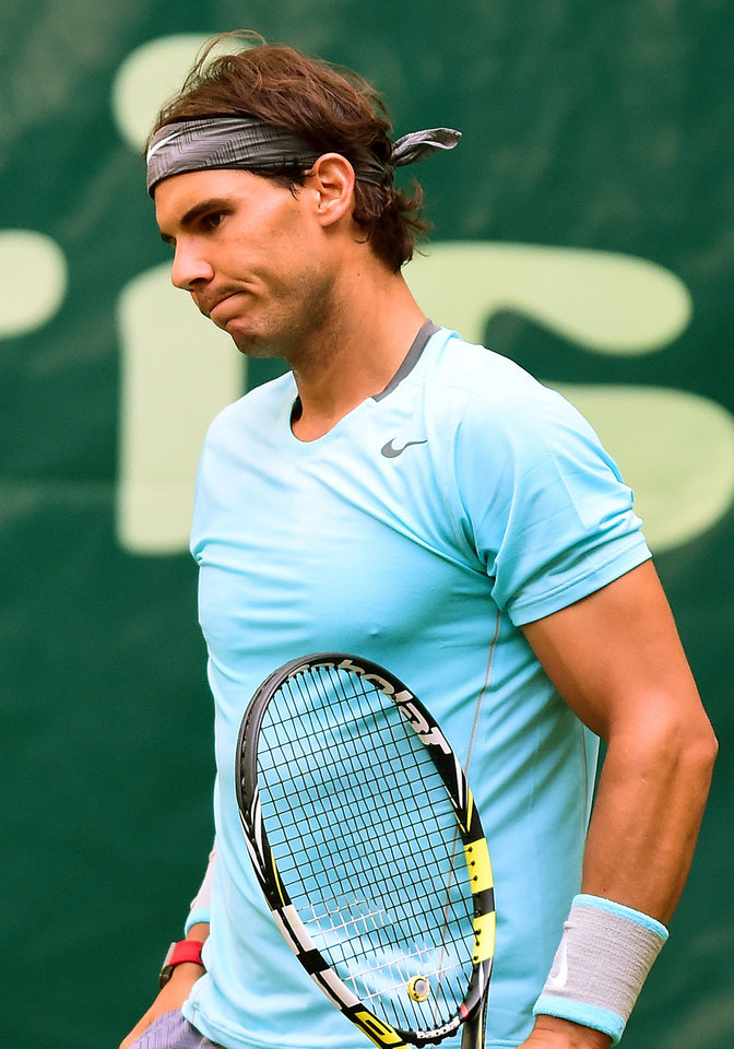 Photo - Spain's Rafael Nadal reacts after missing a point against Germany's Dustin Brown during the Gerry Weber Open tennis tournament in Halle, Germany, Thursday, June 12, 2014. Nadal lost the match with 4-6 and 1-6. (AP Photo/dpa,Christian Weische)