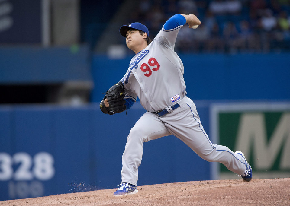 Photo - Los Angeles Dodgers starting pitcher Hyun-Jin Ryu throws during the first inning of a game against the Toronto Blue Jays  in Toronto on Monday July 22, 2013. (AP Photo/The Canadian Press, Frank Gunn)