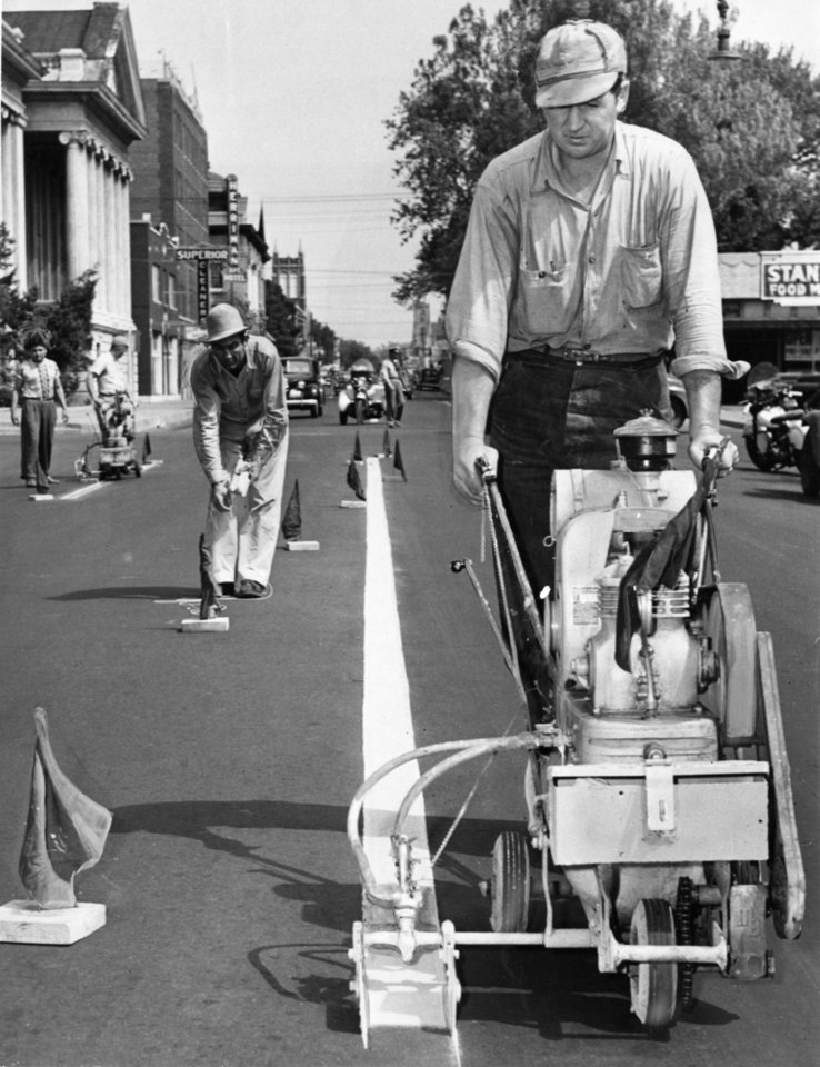 Photo - A crew paints stripes and dots along Robinson Avenue to designate new traffic lanes open for motorists southbound in the morning rush and northbound in the afternoons, in this photo from April 1948.  The Oklahoman archives