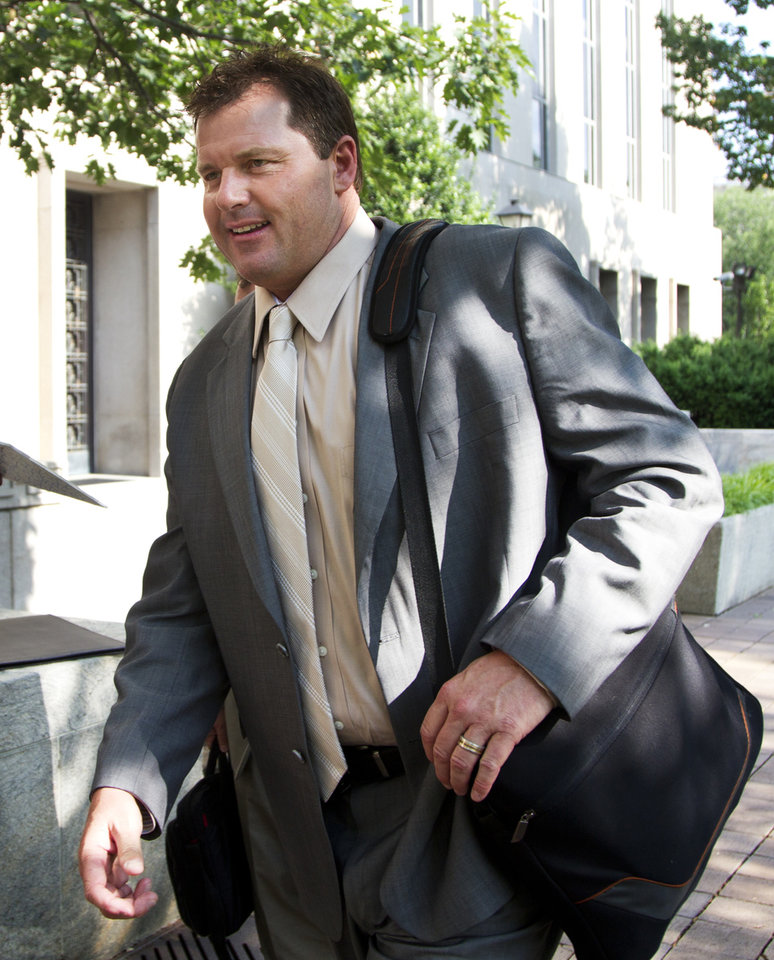Photo -   Former Major League Baseball pitcher Roger Clemens, who is accused of lying to Congress in 2008 when he denied using performance-enhancing drugs, leaves federal court in Washington, Friday, May 25, 2012. A forensic scientist testified Friday that two cotton balls and a syringe needle allegedly saved after a steroids injection tested positive for Roger Clemens' DNA, a key moment as the government tries to prove the former pitcher used performance-enhancing drugs. (AP Photo/Manuel Balce Ceneta)