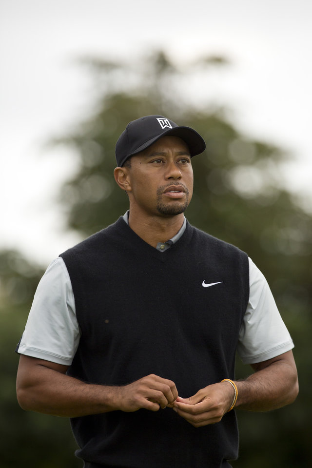 Photo - Tiger Woods of the US walks off the 18th tee after a practice round at Royal Liverpool Golf Club prior to the start of the British Open Golf Championship, in Hoylake, England, Saturday, July 12, 2014. The 2014 Open Championship starts on Thursday July 17. (AP Photo/Jon Super)