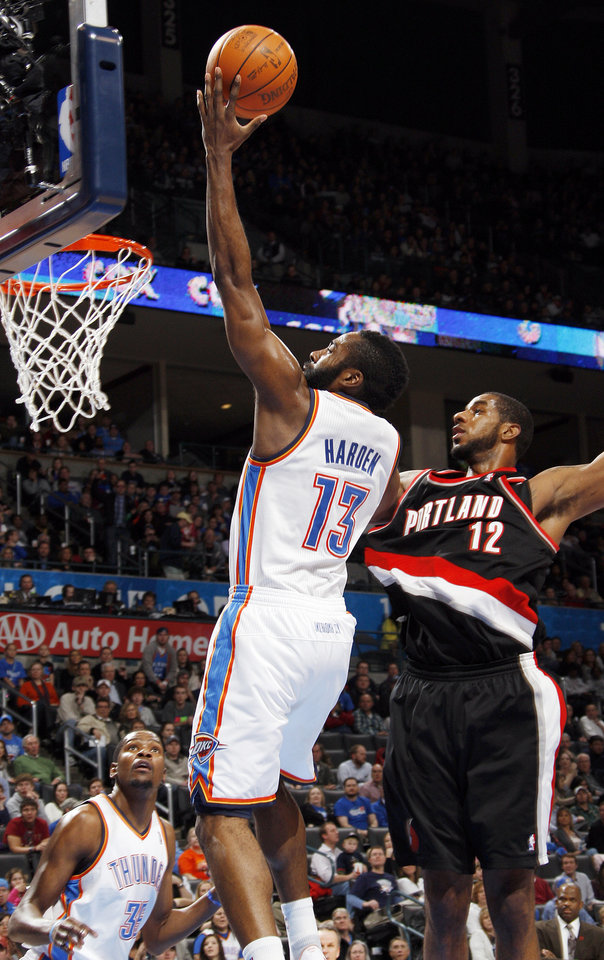 Oklahoma City\'s James Harden (13) takes the ball to the hoop in front of Portland\'s LaMarcus Aldridge (12) as Kevin Durant (35) of Oklahoma City looks on in the second half during the NBA basketball game between the Oklahoma City Thunder and Portland Trail Blazers at Chesapeake Energy Arena in Oklahoma City, Tuesday, Jan. 3, 2012. Portland won, 103-93. Photo by Nate Billings, The Oklahoman