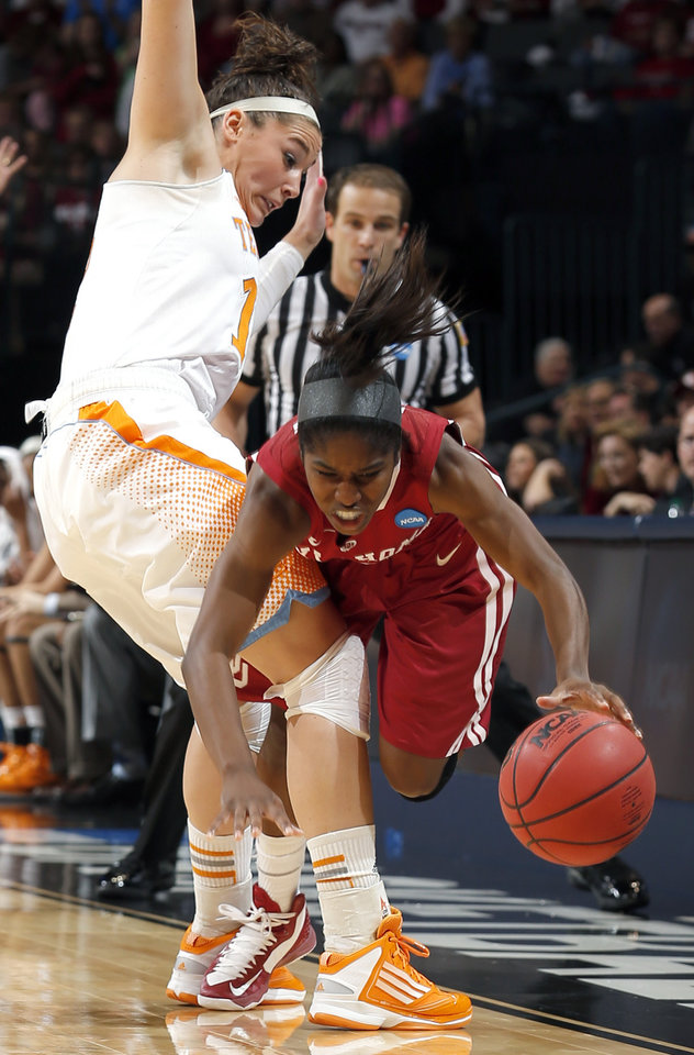 Photo - Oklahoma's Aaryn Ellenberg (3) tries to get by  Tennessee's Taber Spani (13 during the college basketball game between the University of Oklahoma and the University of Tennessee at the  Oklahoma City Regional for the NCAA women's college basketball tournament at Chesapeake Energy Arena in Oklahoma City, Sunday, March 31, 2013. Photo by Sarah Phipps, The Oklahoman