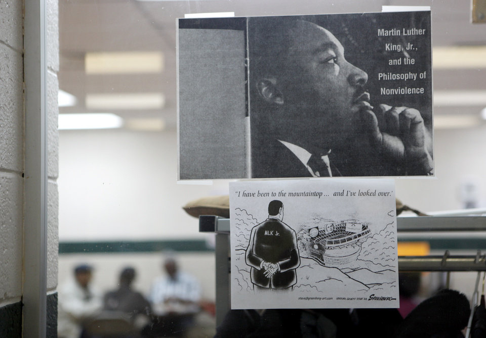 Photo - Poster about Martin Luther King, Jr., hangs on a window at the Lincoln Senior Center, 4712 North Martin Luther King Avenue, Wednesday Jan. 13, 2009, in Oklahoma City. Photo by Sarah Phipps, The Oklahoman ORG XMIT: KOD