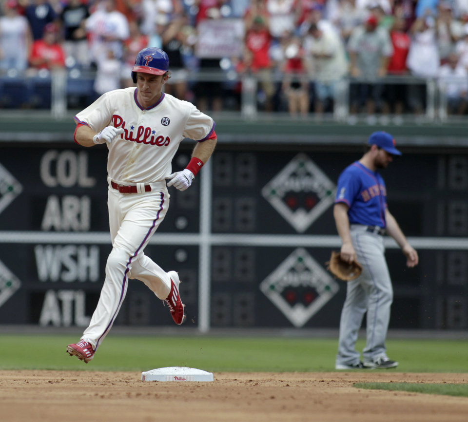 Photo - Philadelphia Phillies' Chase Utley runs the bases after he hit a solo home run against the New York Mets in the first inning of a baseball game Sunday, Aug. 10, 2014, in Philadelphia.  (AP Photo/H. Rumph Jr)