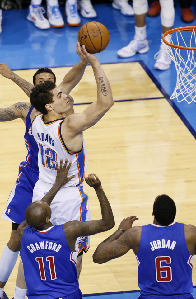 Photo - Steven Adams (12) goes to the basket during Game 5 of the Western Conference semifinals in the NBA playoffs between the Oklahoma City Thunder and the Los Angeles Clippers at Chesapeake Energy Arena in Oklahoma City,  Tuesday, May 13, 2014. Photo by Bryan Terry, The Oklahoman