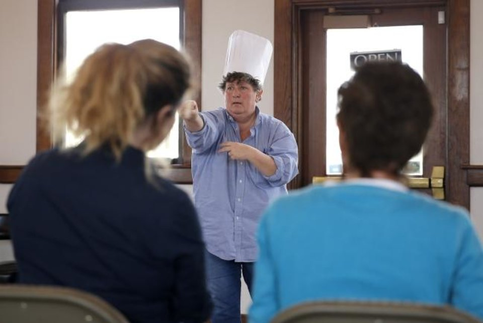 Photo -  Sheryl Martin, artistic director of Norman's Namron Players Theatre, participates April 14, 2018, in a soundpainting workshop at The Depot in Norman. [Sarah Phipps/The Oklahoman Archives]