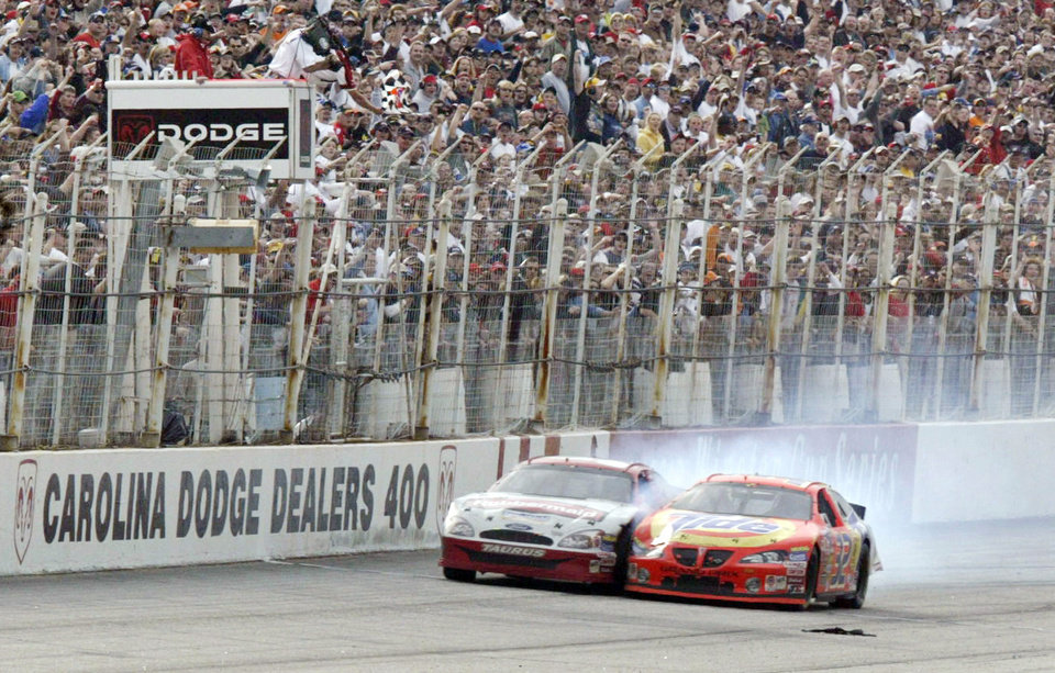Photo - FILE - In this March 16, 2003, file photo, Ricky Craven, right, crosses the finish ahead of Kurt Busch to win the NASCAR Carolina Dodge Dealers 400 Sunday, March 16, 2003, at Darlington Raceway in Darlington, S.C. It was 10 years ago that Busch came up an agonizing .002 seconds shy of victory to Ricky Craven at the track