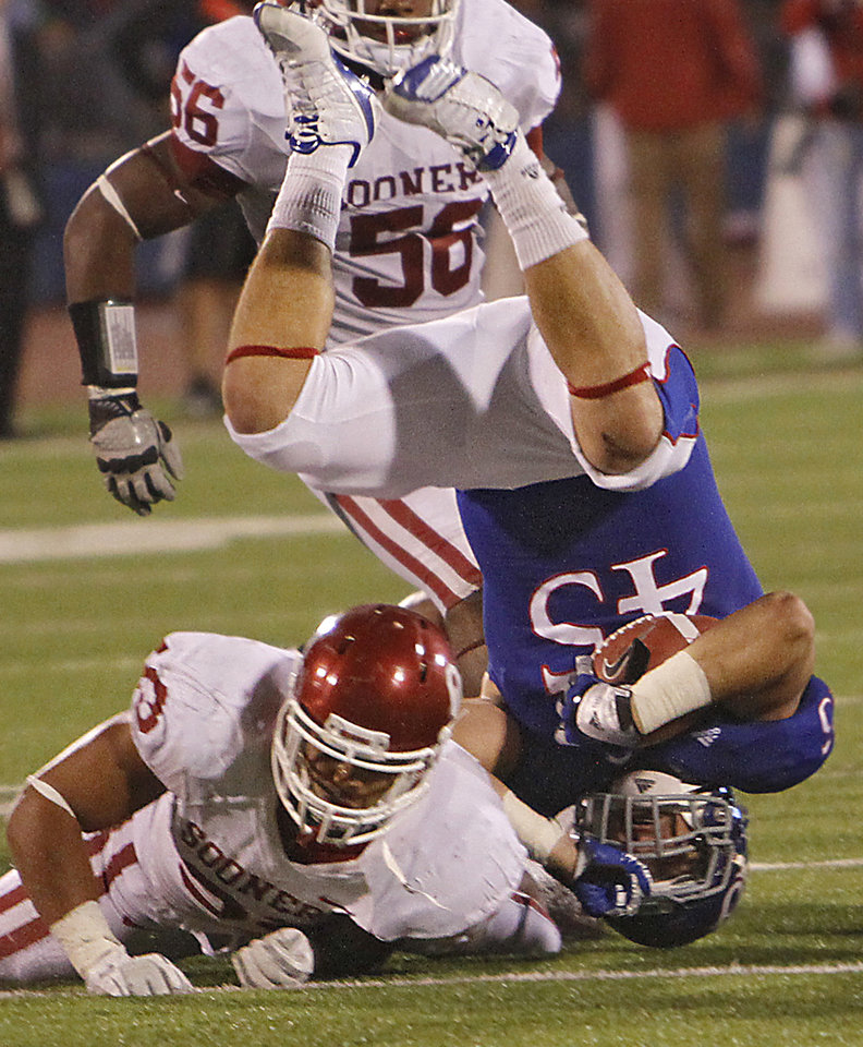 Photo - Oklahoma's Trey Millard (33) upends Kansas' Nick Sizemore (45) on a kick return during the college football game between the University of Oklahoma Sooners (OU) and the University of Kansas Jayhawks (KU) on Sunday, Oct. 16, 2011. in Lawrence, Kan. Photo by Chris Landsberger, The Oklahoman
