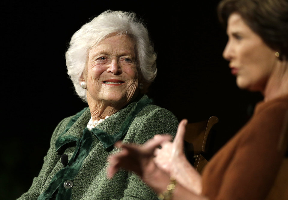 Former first ladies Barbara Bush, left, and Laura Bush, take part in the Enduring Legacies of America�s First Ladies conference Thursday, Nov. 15, 2012, in Austin, Texas. Family members, former staff members, historians, and White House insiders were also spoke as part of the program. (AP Photo/David J. Phillip)