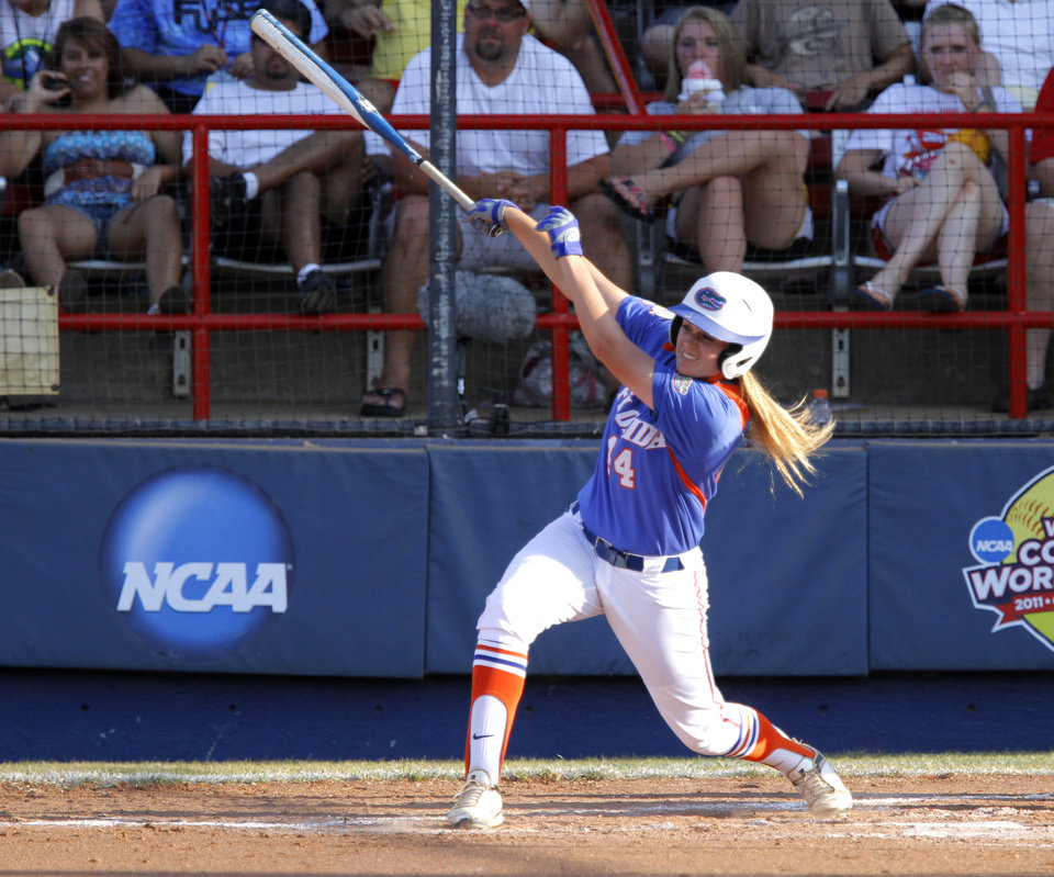 Photo - Florida's Brittany Schutte (44) follows through on a hit during the Women's College World Series game between Florida and Alabama at the ASA Hall of Fame Stadium in Oklahoma City, Sunday, June 5, 2011. Photo by Sarah Phipps, The Oklahoman
