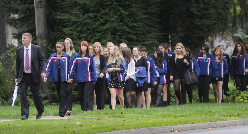 Members of the New Hartford senior High School girls swim team walk toward St. John the Evangelist Church for Alexandra Kogut's funeral in New Hartford on Thursday, Oct. 4. 2012. Kogut's body was found early Saturday in her dorm room at the State University of New York College at Brockport, near Rochester. Her boyfriend Clayton Whittemore, of New Hartford, is charged with the killing. (AP Photo/Observer-Dispatch, Tina Russell)