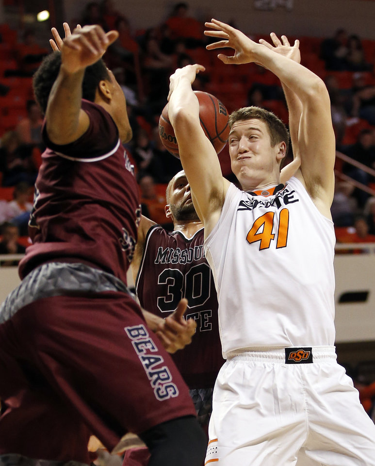 Photo - OSU's Mitchell Solomon (41) loses the ball between Missouri State's Dequon Miller (4), left, and Camyn Boone (30) during a men's college basketball game between Oklahoma State and Missouri State at Gallagher-Iba Arena in Stillwater, Okla., Saturday, Dec. 5, 2015. Missouri State won 64-63. Photo by Nate Billings, The Oklahoman