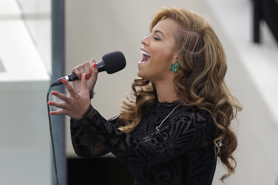 Photo - Beyonce sings the National Anthem at the ceremonial swearing-in for President Barack Obama at the U.S. Capitol during the 57th Presidential Inauguration in Washington, Monday, Jan. 21, 2013. (AP Photo/Evan Vucci)  ORG XMIT: CAP356