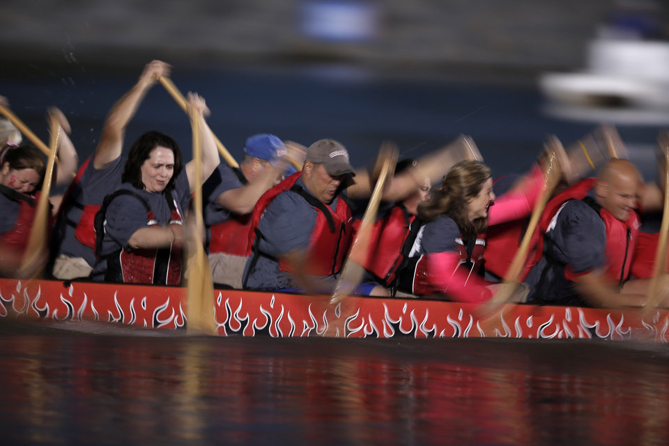 A dragon boat team races in Paddle For The Cure during the Oklahoma Regatta Festival on the Oklahoma River in Oklahoma City, Thursday, Sept. 27, 2012. Photo by Garett Fisbeck, The Oklahoman