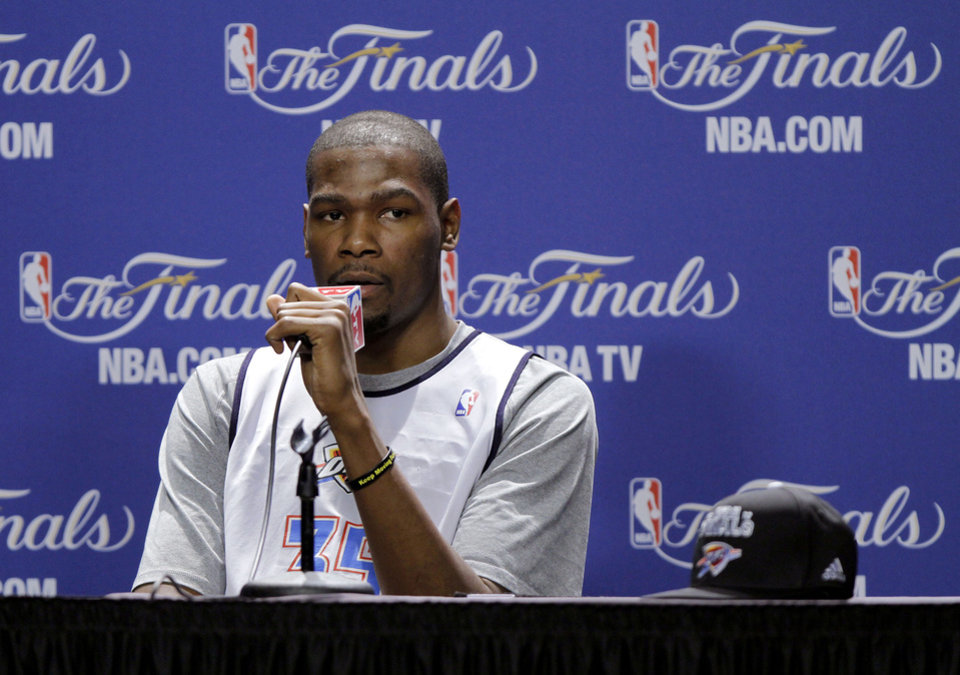 Photo - Oklahoma City's Kevin Durant answers a question during a press conference for Game 3 of the NBA Finals between the Oklahoma City Thunder and the Miami Heat at American Airlines Arena in Miami, Saturday, June 16, 2012. Photo by Bryan Terry, The Oklahoman