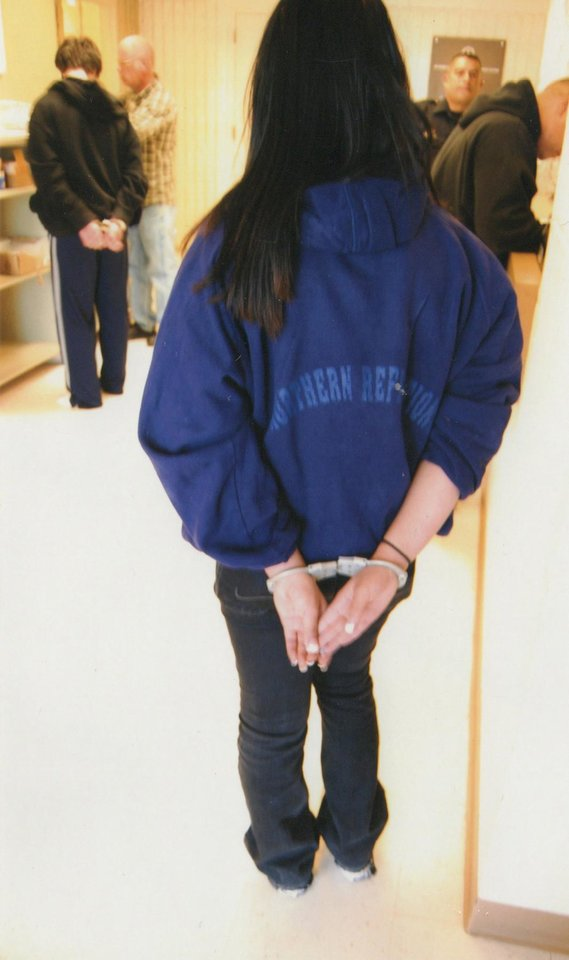 Photo -   This undated image provided by the City of Albuquerque via Shannon Kennedy shows a school-aged juvenile handcuffed in Albuquerque, N,M. Whether its ticketing students in Texas or handcuffing them from New Mexico to Massachusetts, experts say the criminalization of bad behavior at school is the outgrowth of zero-tolerance policies that have led to increased police presence in schools over the years. (AP Photo/City of Albuquerque via Shannon Kennedy)