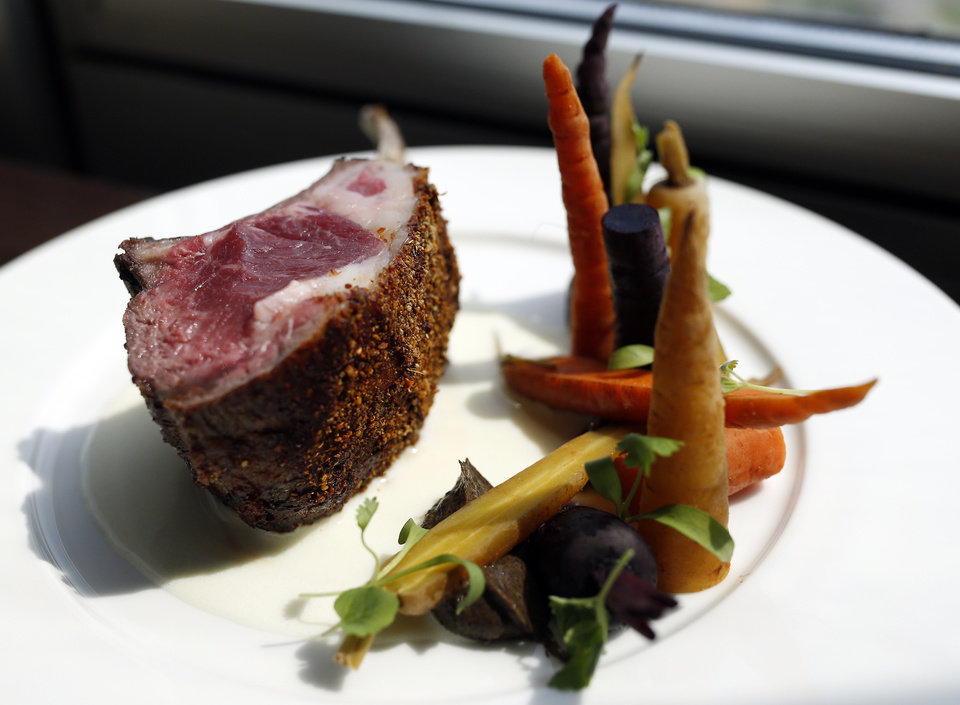 Photo - A rack of lamb and carrots are pictured at the The George Prime Steakhouse in Oklahoma City, Thursday, June 20,  2014. Photo by Sarah Phipps, The Oklahoman