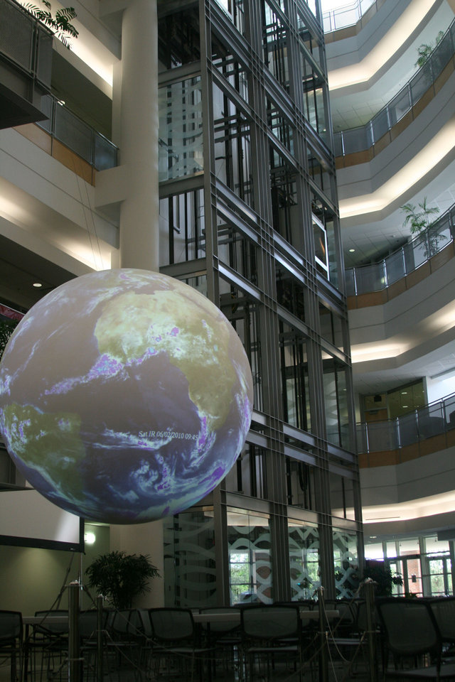 Science on a Sphere displays the world�s weather in the atrium of the National Weather Center in Norman. Photo Provided