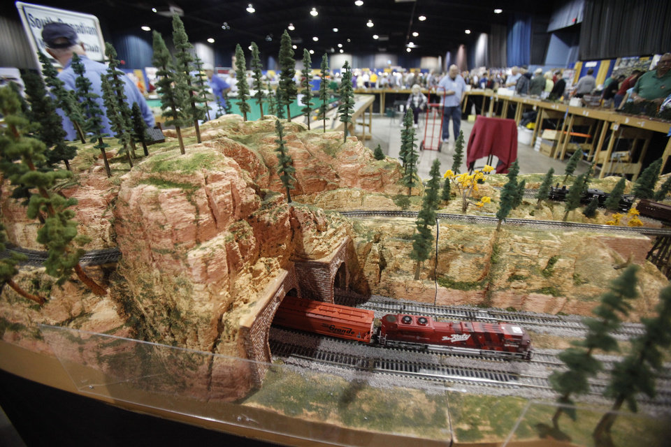 Photo - A model train exits a tunnel during the OKC Train Show at State Fair Park in Oklahoma City, OK, Saturday, December 1, 2012,  By Paul Hellstern, The Oklahoman