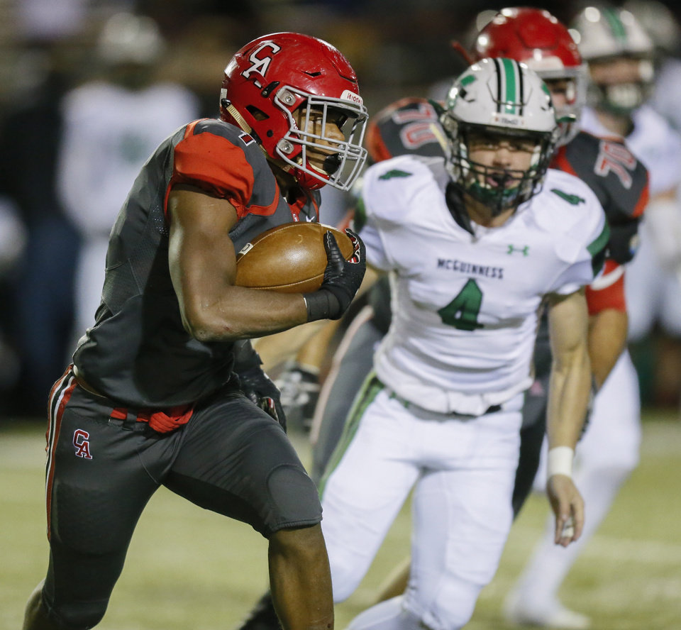 Photo - Carl Albert's Javion Hunt (1) carries the ball during a high school football game between Bishop McGuinness and Carl Albert at Gary Rose Stadium in Midwest City, Okla., Friday, Nov. 8, 2019. [Nate Billings/The Oklahoman]