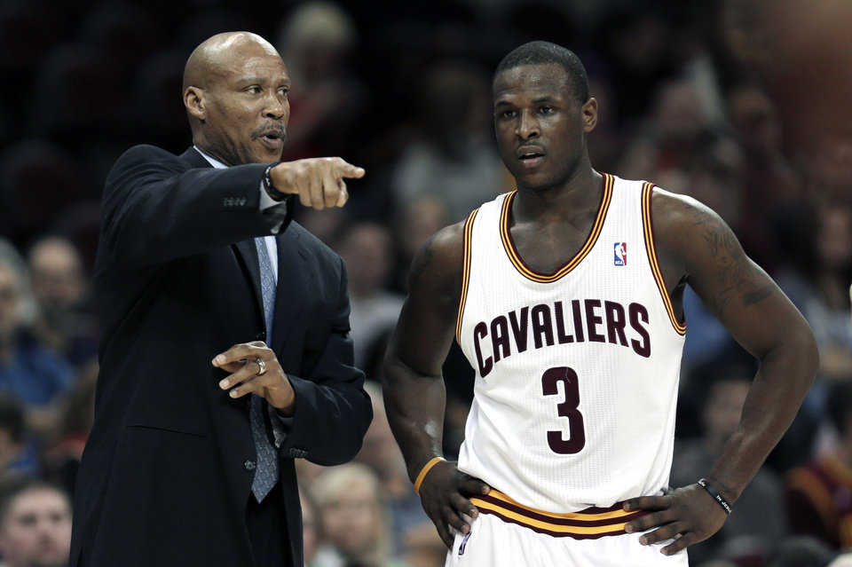 Cleveland Cavaliers head coach Byron Scott, left, talks with Dion Waiters during the second quarter of an NBA basketball game against the Indiana Pacers, Friday, Dec. 21, 2012, in Cleveland. The Pacers won 99-89. (AP Photo/Tony Dejak)