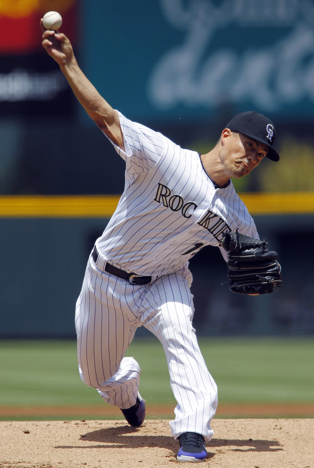Photo -   Colorado Rockies starting pitcher Jeremy Guthrie works to Seattle Mariners leadoff hitter Dustin Ackley in the first inning of an interleague baseball game in Denver, Sunday, May 20, 2012. (AP Photo/David Zalubowski)