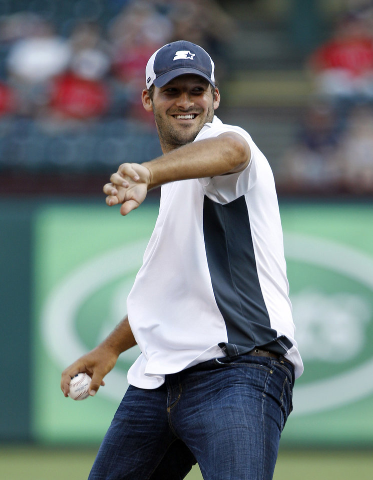 Photo -   Dallas Cowboys quarterback Tony Romo winds up to throw the ceremonial first pitch before a baseball game between the Seattle Mariners and the Texas Rangers, Wednesday, May 30, 2012, in Arlington, Texas. (AP Photo/Tony Gutierrez)